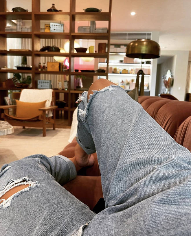Chrissy Teigen shares a snap of her on her sofa while explaining how she feels following the bullying scandal.