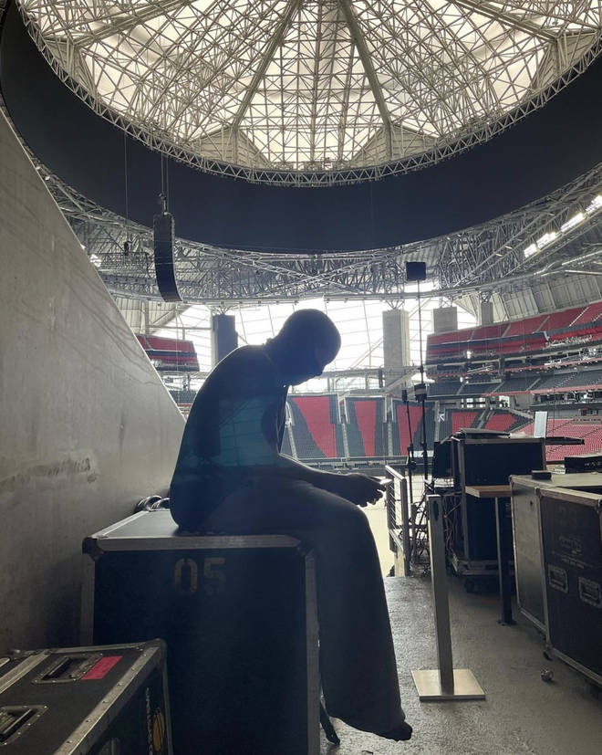 Kanye West shares photo of himself in the Mercedes-Benz Stadium in Atlanta at his listening event.
