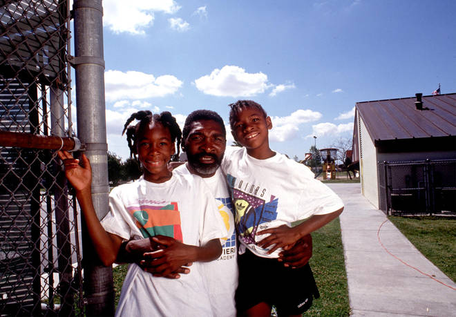 Tennis players Venus and Serena Williams pose with their dad Richard,  in Compton, 1991.