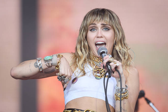 Miley Cyrus says she is 'dedicated to encouraging love, acceptance, and open mindedness' during her post about DaBaby's homophobic comments,
