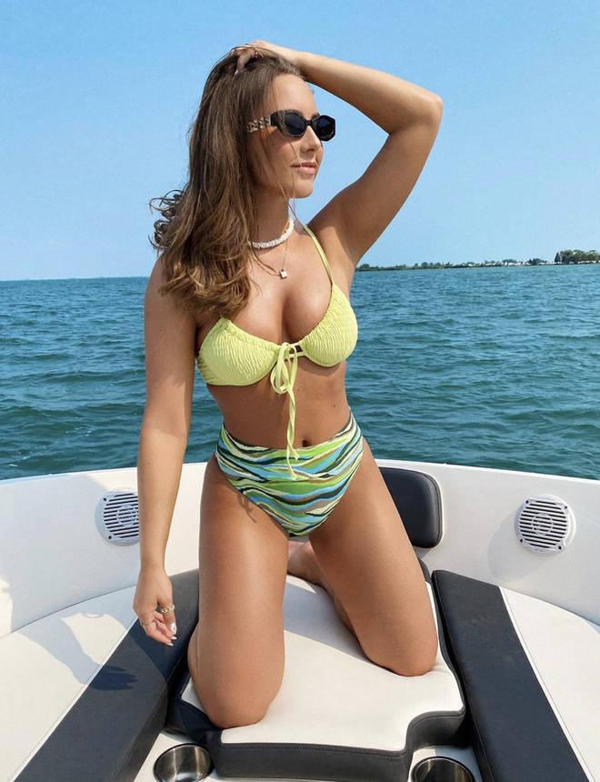 Hailie wears a lime green bikini on a boat