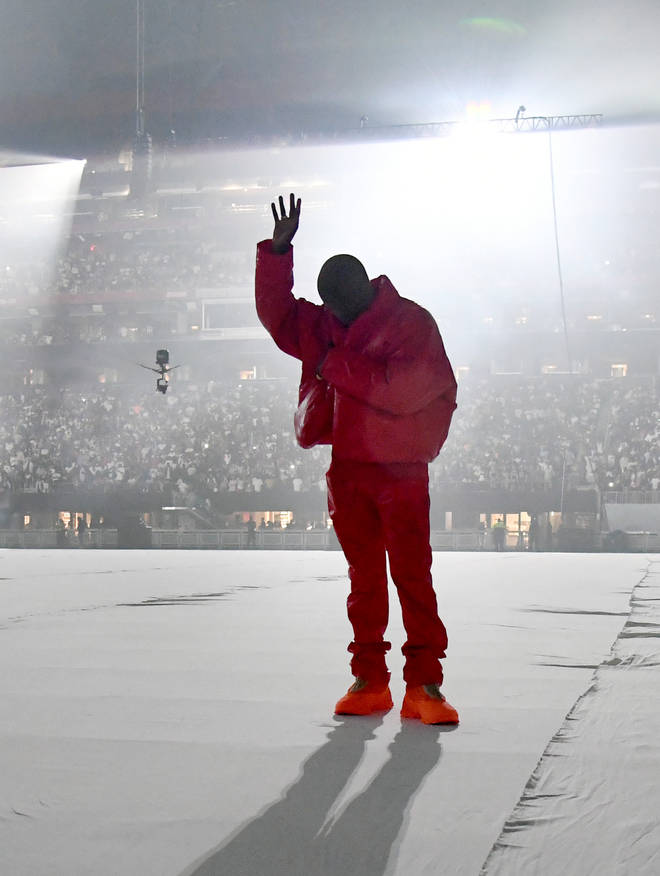 Kanye West sported his Yeezy X Gap red jacket at his previous listening event at Mercedes-Benz stadium.