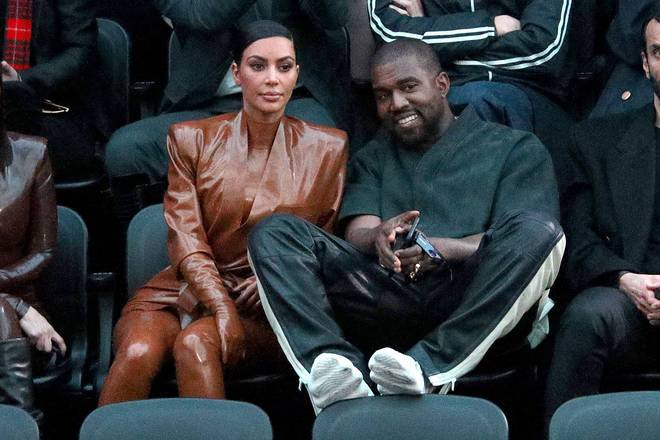 Kim Kardashian and Kanye West have sparked reconciliation rumours after she appeared in a wedding dress at his 'Donda' event.