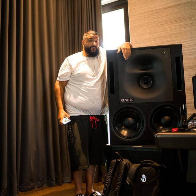 DJ Khaled standing with speakers