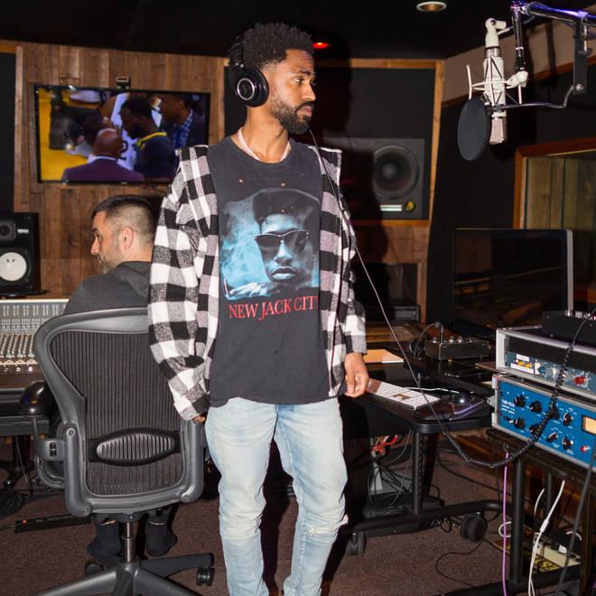 Big Sean wearing headphones