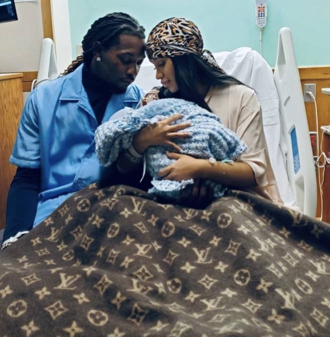 Offset and Cardi B holding their little boy while being pictured at the hospital.