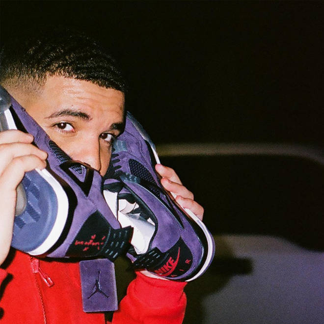 Drake Holding Trainers To His Ear