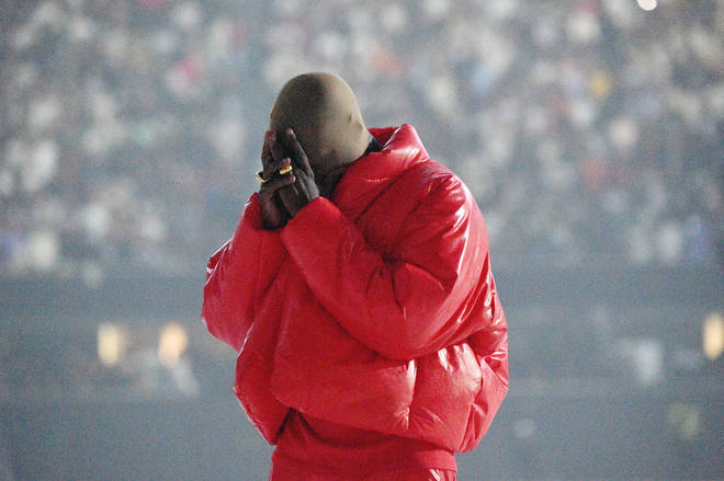 Kanye West wears Yeezy X Gap jacket at his Donda listening event at Mercedes-Benz Stadium in July.