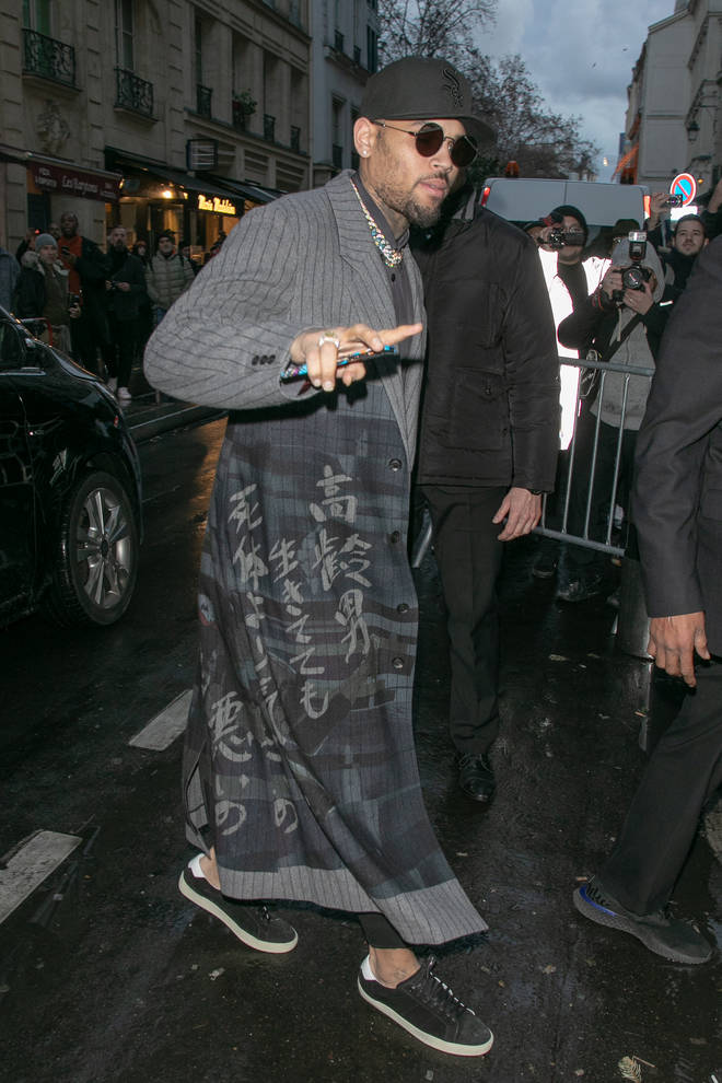 Chris Brown attended Paris Fashion Week before he was arrested following a rape claim