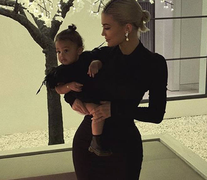 Kylie poses with Stormi