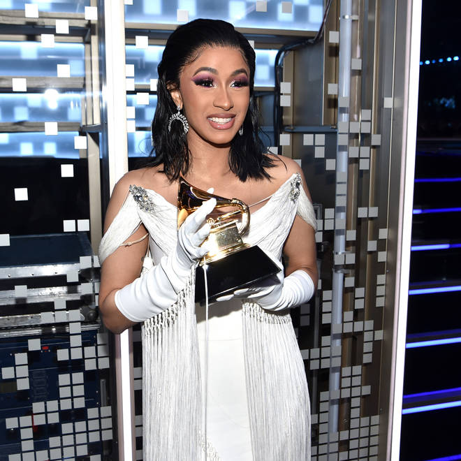 Cardi B clutching her Grammy Award for 'Best Rap Album.'