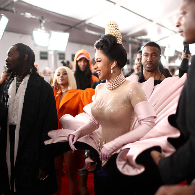 The rapstress wore a striking outfit on the Grammy red carpet.
