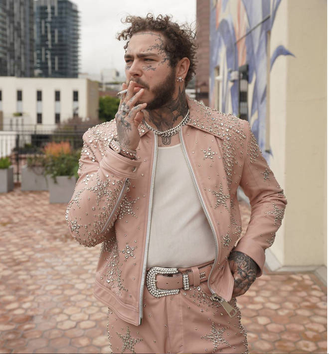 Post Malone posts photo of him smoking a cigarette just one day before he lights an expensive one on stage