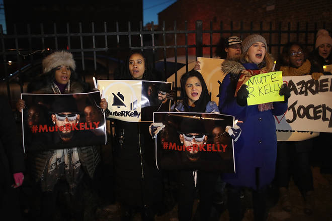 Protesters march to 'Mute R. Kelly' at his studio in Chicago