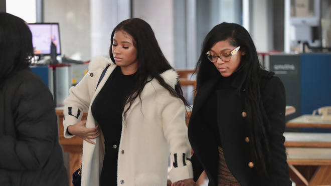 Azriel Clary and Jocelyn Savage held hands as they arrived for R Kelly's bond hearing