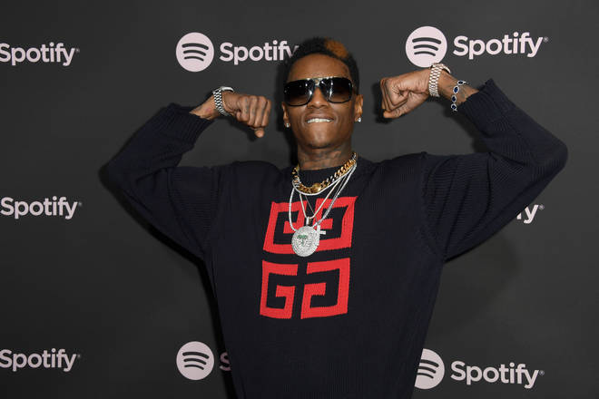 Soulja Boy puts his arms up and shows off his guns - ready to fight Jake Paul