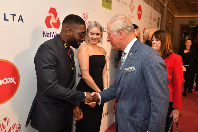 Tinie Tempah was attending a Prince's Trust event when he showed off his newborn daughter.