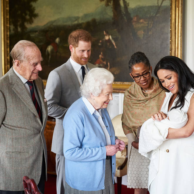 Prince Archie Harrison Mountbatte-Windsor is introduced to The Queen by Meghan Markle and Prince Harry