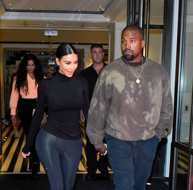 Kim and Kanye's surrogate is in labour with the couple's fourth child.