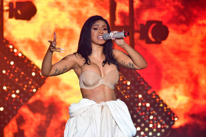 Cardi B returned to the stage wearing a white bathrobe over her underwear.