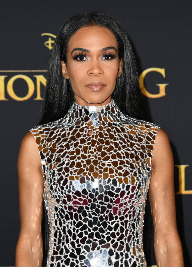 Michelle stunned in a silver-plated dress at the premiere of Disney's 'The Lion King' in Hollywood.
