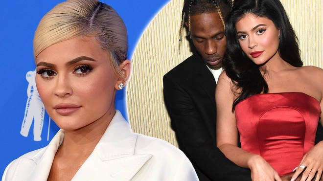 Kylie Jenner & Travis Scott have been spotted boarding a plane with a 'wedding dress' & 'suit'