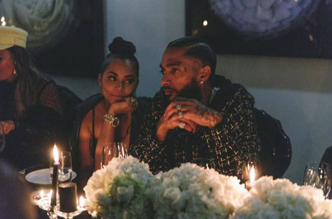 The actress, 34, gazes adoringly at Nipsey during dinner in a touching throwback picture shared by Lauren.