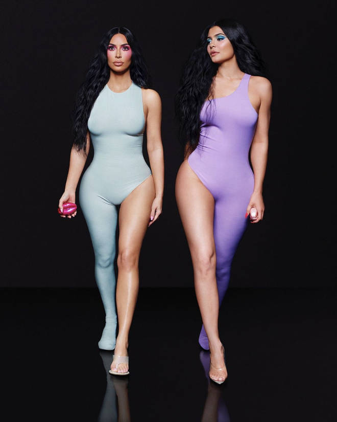 Kim Kardashian and half-sister Kylie Jenner strut their stuff for their new campaign - but an apparent photoshop blunder left fans questioned why they appeared to have 'six toes'.