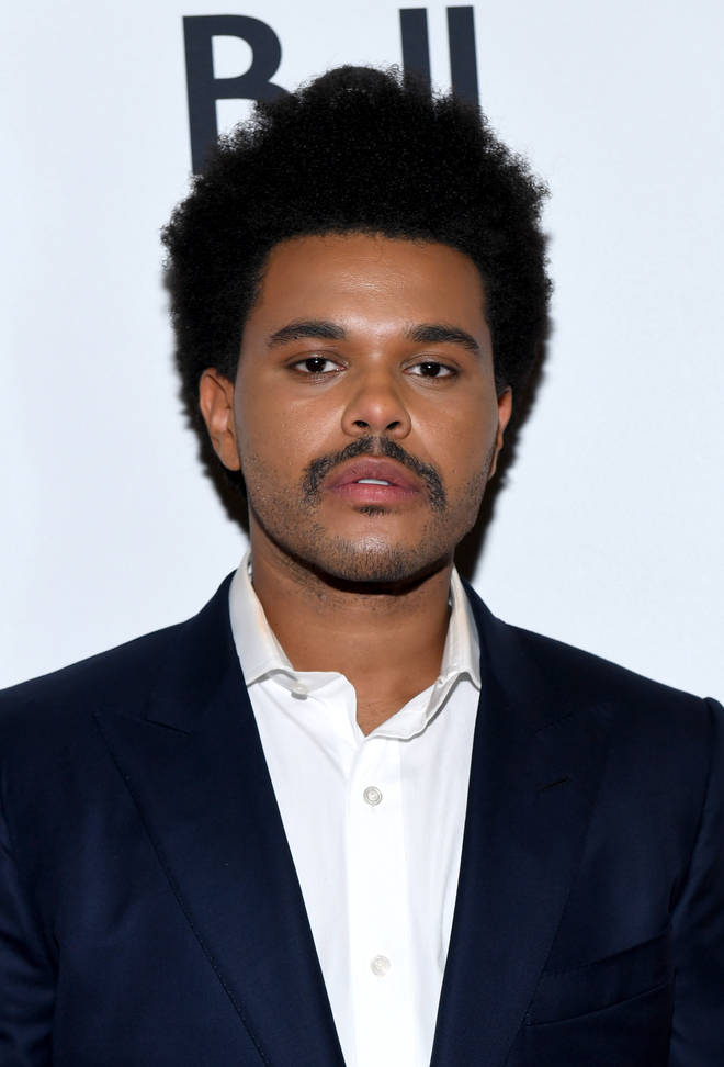 """The Weeknd just turned into Nacho Libre,"" one user commented on the singer&squot;s new &squot;do. (Pictured here at the 2019 Toronto International Film Festival.)"