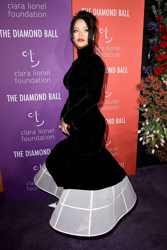 Rihanna was spotted clutching her stomach on the red carpet at the 5th Annual Diamond Ball.