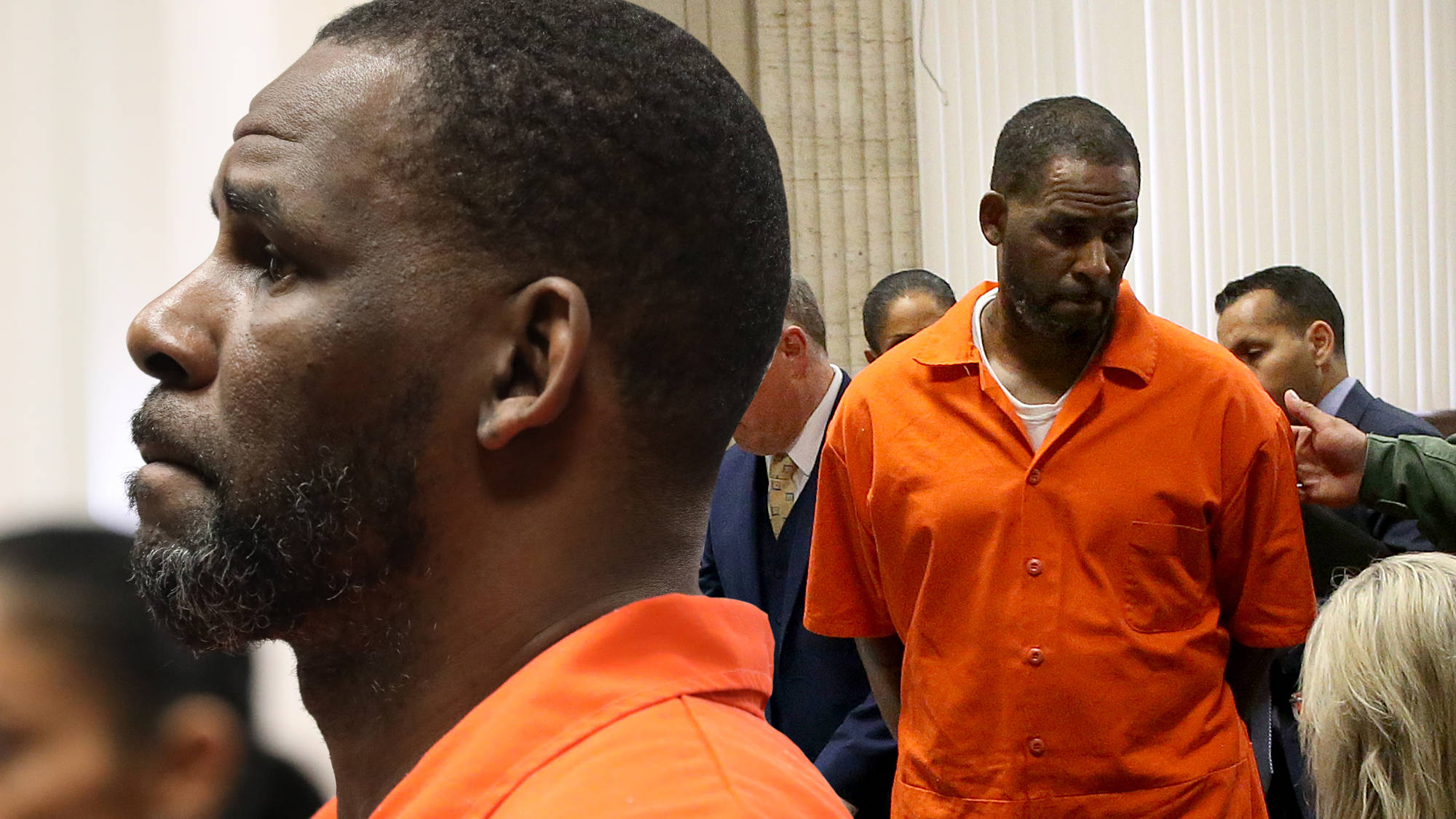 """R. Kelly Accused Of Blackmailing Alleged Victim With """"Compromising Photographs"""""""