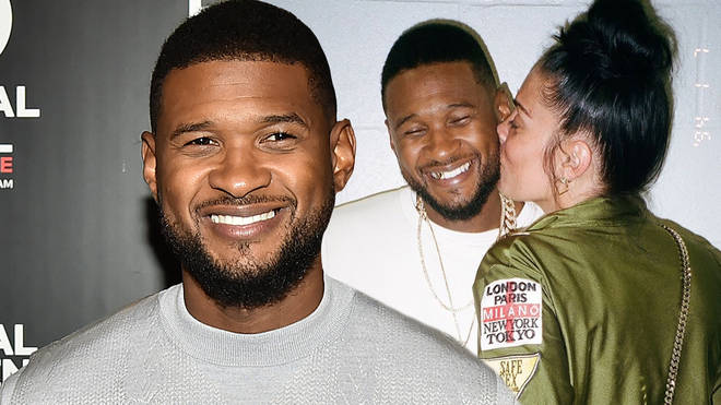 Usher was pictured capturing a kiss from a mystery girl.