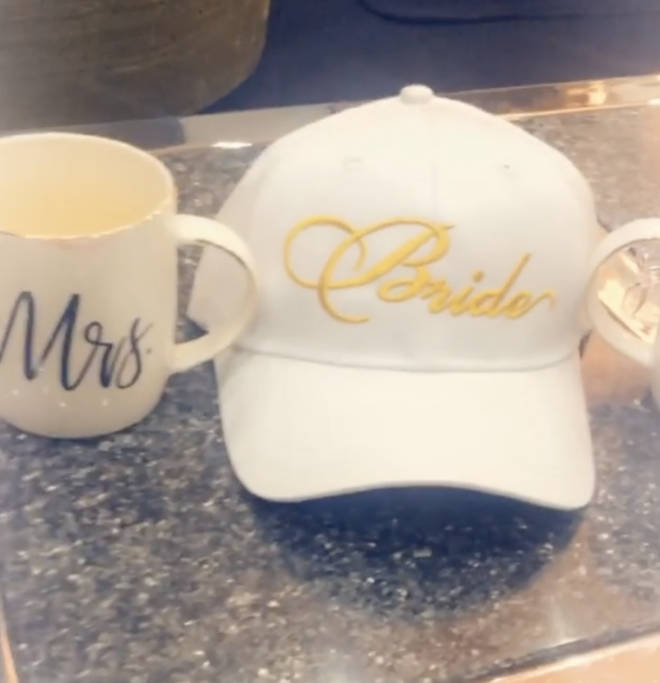 Minaj shared a clip of the couple's matching 'Mr and Mrs' coffee mugs and 'Bride and Groom' baseball caps.