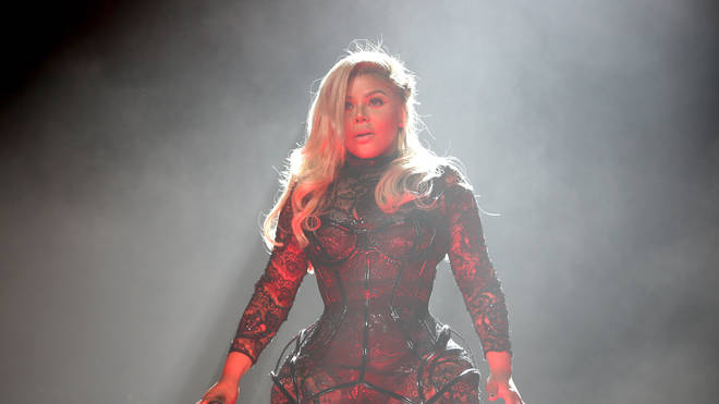 Lil Kim on stage at the Bad Boy Family Reunion Tour 2016
