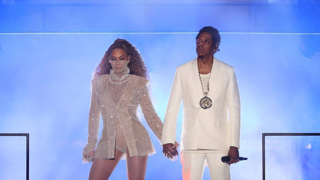 Beyonce and Jay Z on stage during the On The Run II Tour in Cardiff.